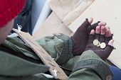 pic of homeless  - Hands of homeless person holding a few cents - JPG