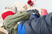 foto of sleeping bag  - Poor frozen male sleeping on a street on cold day - JPG