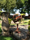 image of rosslyn  - Metal Sundial in garden with stone pedestal at Rosslyn Chapel Scotland UK - JPG