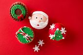 Christmas theme cupcakes in traditional red green colors and candy elements from overhead