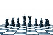 pic of chess pieces  - chess pieces on a chess board showing concept for strategic business - JPG