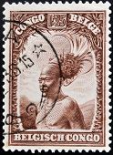 A stamp printed in Belgian Congo shows Head of a native men