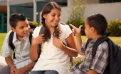 stock photo of school child  - Cute Brothers and Sister Wearing Backpacks Ready for School - JPG