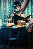 pic of post-apocalypse  - Portrait of a beautiful steampunk woman over vintage background - JPG