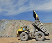 stock photo of iron ore  - unloading truck in a career of iron ore - JPG