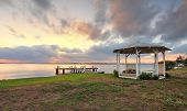 picture of gazebo  - Sunset on Lake Macquarie with jetty and white lattice gazebo in view - JPG