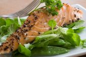 stock photo of mange-toute  - Salmon on bed of spinach mange tout and rocket - JPG