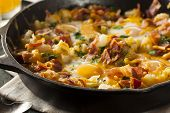 picture of scrambled eggs  - Homemade Hearty Breakfast Skillet with Eggs Potatoes and Bacon - JPG