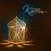 pic of muslim  - Illuminated arabic lamp or lantern design on shiny brown background for holy month of muslim community Ramadan Kareem - JPG