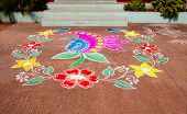 image of rangoli  - Traditional Rangoli Design with Coloured Powders in Floral Design at the Doorsteps of an Indian House - JPG