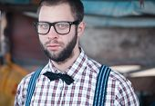 stock photo of redneck  - Redneck nerd man in glasses with beard outdoor - JPG