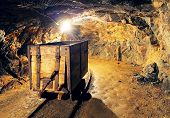 stock photo of iron ore  - Mining cart in silver gold copper mine - JPG