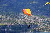 foto of annecy  - paraglider flying over Lake Annecy in the French Alps - JPG