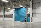 stock photo of roller door  - Shutter door or rolling door blue color night scene - JPG
