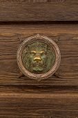 stock photo of lions-head  - Old knocker in the form of a lion - JPG