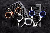 foto of taper  - professional tools of hairdresser in black case - JPG