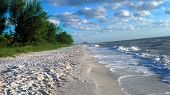 stock photo of breathtaking  - Breathtaking view of the white sand beach and blue Gulf water of Wiggins State Park in Naples, FL.