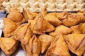 foto of samosa  - A pile of savory stuffed Indian snacks  - JPG