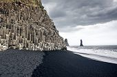 picture of promontory  - The black sand beach of Reynisfjara and the mount Reynisfjall from the Dyrholaey promontory in the southern coast of Iceland - JPG