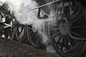 picture of locomotive  - Steam locomotive rolling by close - JPG