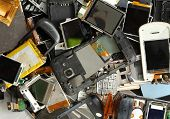 stock photo of piles  - Pile of old and damage mobile phone scrap - JPG