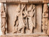 stock photo of vedic  - An ancient sculpture of the Hindu god Rama and Lakshman carved into a temple column - JPG