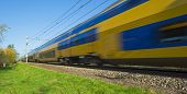 picture of high-speed train  - Passenger train moving at high speed in autumn - JPG