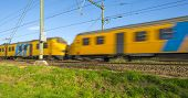 image of high-speed train  - Passenger train moving at high speed in autumn - JPG