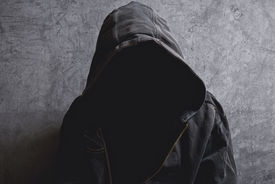 image of incognito  - Faceless unknown and unrecognizable man withouth identity wearing hood in dark room spooky criminal person - JPG
