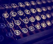 picture of typewriter  - close up on the keys of an antique typewriter toned with a retro vintage instagram filter app or action effect  - JPG