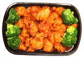 stock photo of chickens  - To go or delivery container of general tso chicken and broccoli - JPG