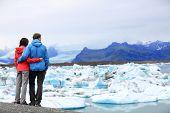 picture of arctic landscape  - Tourists couple romantic on Iceland Jokulsarlon glacial lagoon  - JPG