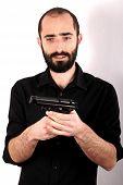 picture of gun shot  - Studio shot of a man holding a gun - JPG