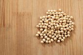 foto of soy bean  - top view of soy bean on the wooden table - JPG