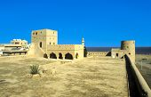 foto of oman  - Sohar Fort in Oman under blue sky  - JPG