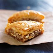 stock photo of wax  - two pieces of baklava on wax paper - JPG