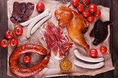 picture of deli  - Assortment of deli meats on parchment - JPG