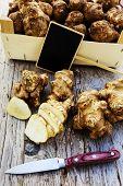 picture of jerusalem artichokes  - Fresh organic topinambur on wooden background - JPG
