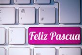 stock photo of pasqua  - feliz pasqua against pink key on keyboard - JPG
