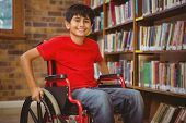 pic of wheelchair  - Portrait of little boy sitting in wheelchair at the library - JPG
