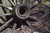 foto of wagon wheel  - This is a very old antique wagon wheel that is weathered from years of sitting outside - JPG