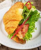pic of avocado  - Fresh croissant for breakfast stuffed with bacon - JPG