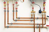 stock photo of copper  - copper pipes in boiler - JPG
