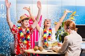 picture of cheers  - Man and woman booking vacation in travel agency cheering for a good deal - JPG