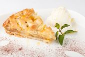picture of ice-cake  - Piece of cake charlotte with apples ice cream and fresh mint on a white plate - JPG