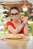 pic of high calorie foods  - Beautiful girl on diet trying to eat a pizza - JPG