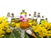 foto of massage oil  - Spa set on banana leaf with many massage oil - JPG