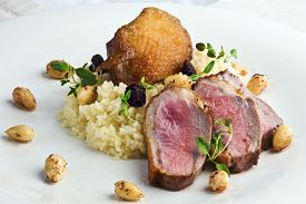 image of crip  - Grilled duck breast served with raisin couscous with fresh thyme and roasted almonds  - JPG