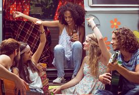 picture of camper  - Hipster friends by camper van at festival on a summers day - JPG