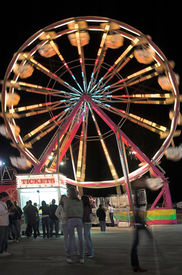 picture of ferris-wheel  - Ferris wheel at the county fair in a time exposure at night  - JPG